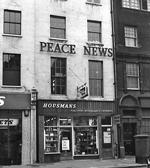 The Peace News logo on the front of 5 Caledonian Road, London, in the 1950s.